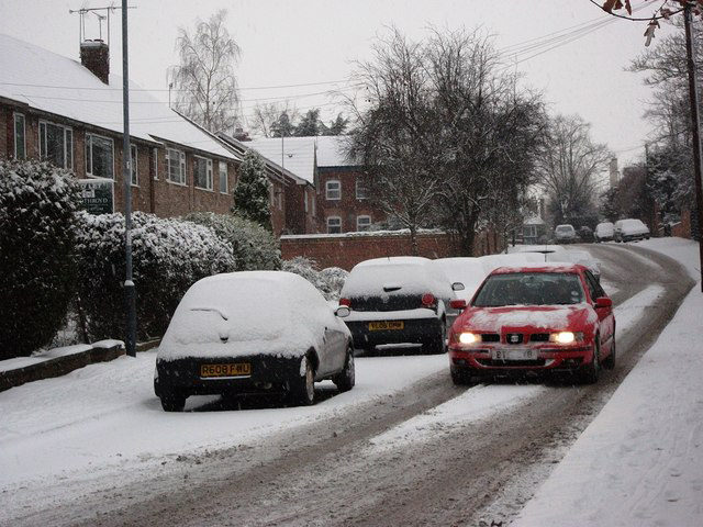 Cars in Snow on Residential Street